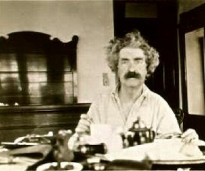 Mark Twain at Breakfast  in 1895 on the US leg of round the world tour.  Photographer probably Major J. B. Pond. steamboattimes.com