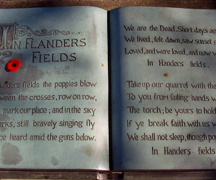 "Inscription of In Flanders Fields in a bronze ""book"" at the John McCrae memorial at his birthplace in Guelph, Ontario."